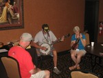Tommy & Patti Routh playing a Tune, while Doc Prince is listening & looking on