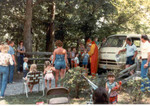 Families gathering for the entertainment by a Clown